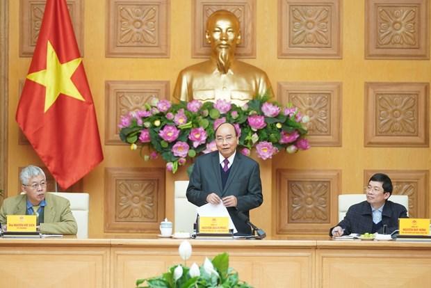 Thu tuong Chinh phu Nguyen Xuan Phuc lam viec voi To tu van kinh te hinh anh 1
