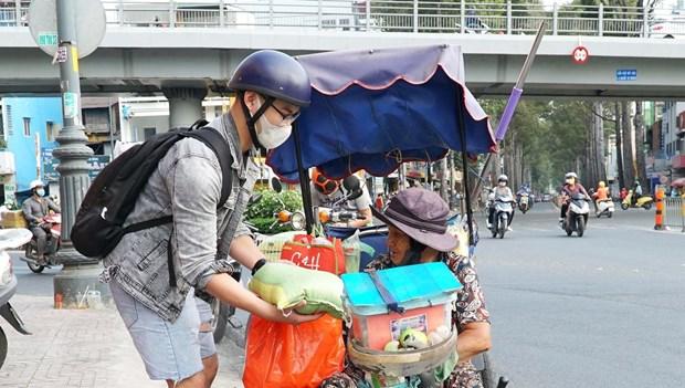 Giam ngheo o Thanh pho Ho Chi Minh: Diem sang giua dai dich COVID-19 hinh anh 1