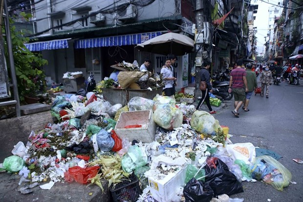 Ha Noi: Hoan tat thu don rac un u tai Nam Tu Liem truoc ngay 31/12 hinh anh 1
