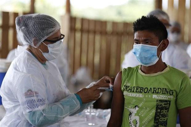 TASS: Hon 300 trieu nguoi tren toan cau da duoc tiem vaccine COVID-19 hinh anh 1