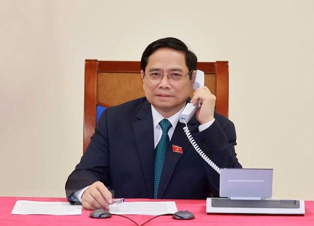 Thu tuong Lao dien dam chuc mung Thu tuong Chinh phu Pham Minh Chinh hinh anh 1