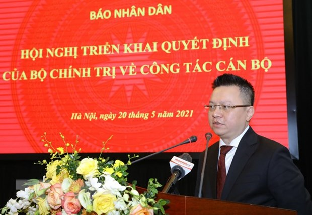 Uy vien TW Dang Le Quoc Minh giu chuc Tong Bien tap Bao Nhan Dan hinh anh 2
