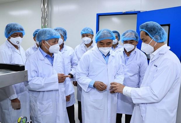 Chu tich nuoc tham doanh nghiep san xuat vaccine Nanocovax hinh anh 1