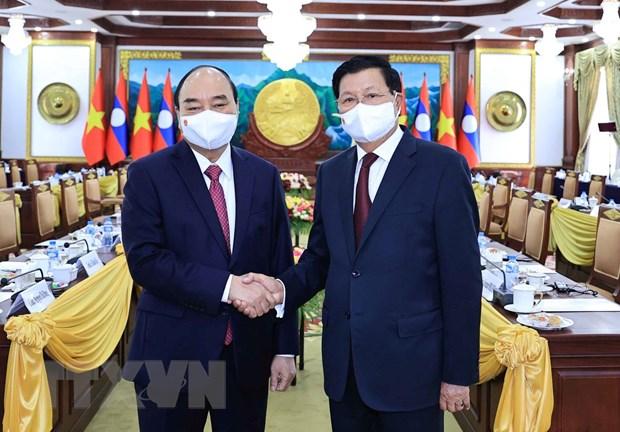 Chủ tịch nước Nguyễn Xuân Phúc và Tổng Bí thư, Chủ tịch nước Lào Thongloun Sisoulith tại buổi hội đàm. (Ảnh: Thống Nhất/TTXVN)