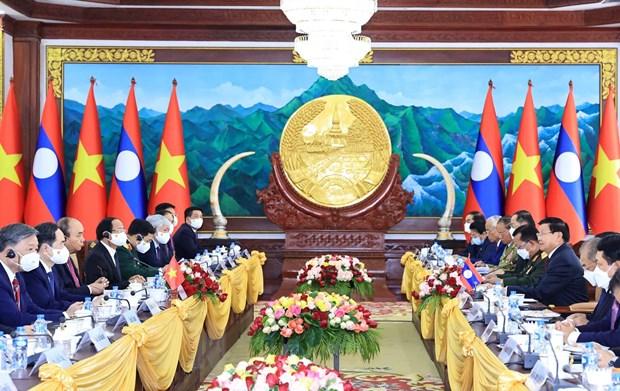 Chủ tịch nước Nguyễn Xuân Phúc hội đàm với Tổng Bí thư, Chủ tịch nước Lào Thongloun Sisoulith. (Ảnh: Thống Nhất/TTXVN)