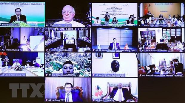 Đại biểu tham dự hội thảo tại các điểm cầu. (Ảnh: Lâm Khánh/TTXVN).