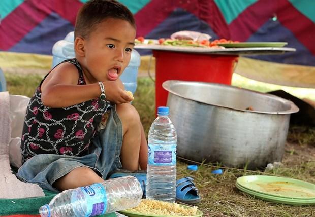 Tiem vacxin cho hon 500.000 tre em tai Nepal sau dong dat hinh anh 1