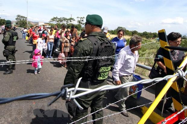 Venezuela va Colombia tam thoi mo lai cua khau bien gioi hinh anh 1