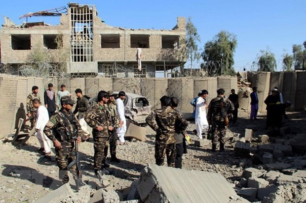 Taliban tan cong don canh sat Afghanistan, 13 nguoi thuong vong hinh anh 1