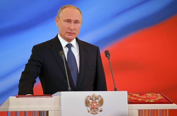 Tong thong Nga Vladimir Putin dang tren duong toi Ao hinh anh 1