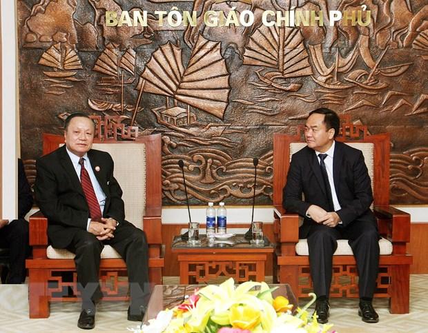 Viet Nam-Lao trao doi kinh nghiem quan ly nha nuoc ve ton giao hinh anh 1
