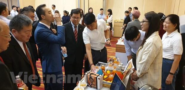 4 doanh nghiep Viet du hoi cho thuc pham chau A-TBD tai Singapore hinh anh 2