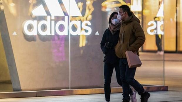 Dich COVID-19: Hang Adidas va Puma lo ngai kinh doanh dinh don hinh anh 1