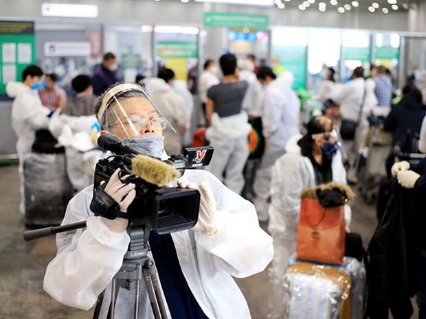 [Photo] TTXVN khong ngung doi moi, nang cao chat luong thong tin hinh anh 48