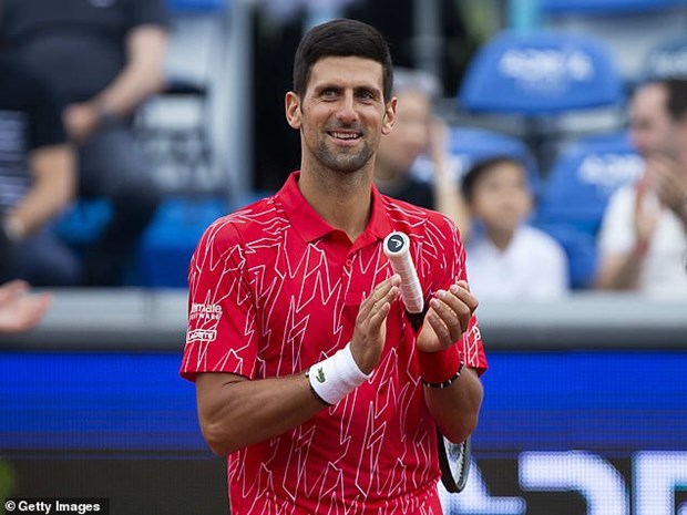Tay vot Novak Djokovic va vo duong tinh voi virus SARS-CoV-2 hinh anh 1