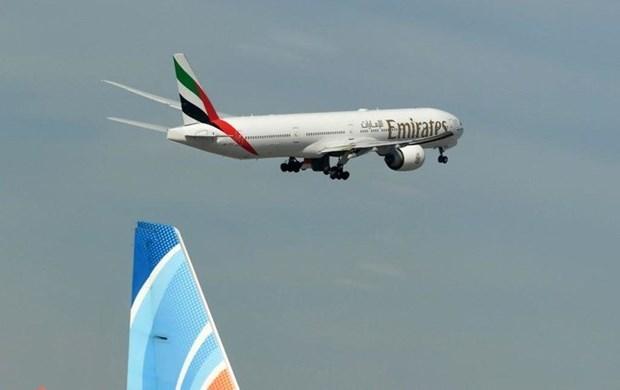 Khach di may bay cua Emirates duoc tra chi phi y te neu mac COVID-19 hinh anh 1