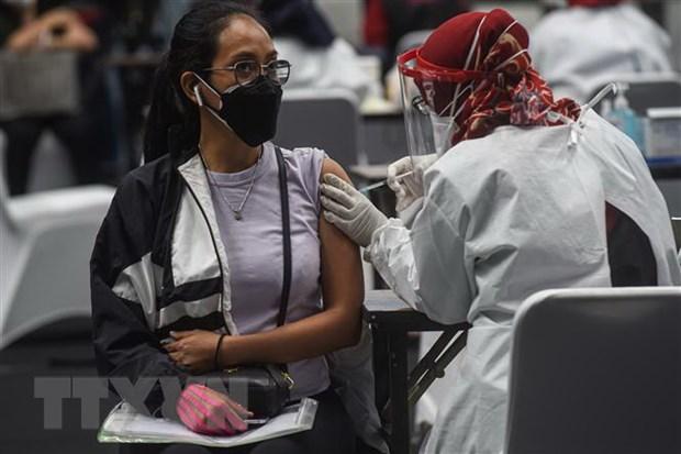Indonesia se tiem chung COVID-19 vao ban dem trong thang Ramadan hinh anh 1