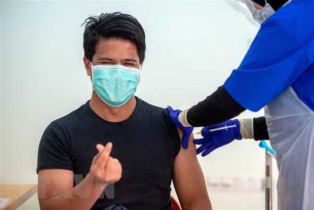 COVID-19: Malaysia cap giay chung nhan tiem chung thong minh hinh anh 1