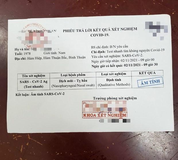 Binh Thuan mo rong dieu tra 2 duong day lam gia giay test COVID-19 hinh anh 1