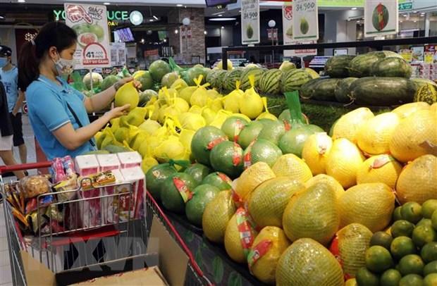 Người dân mua sắm tại siêu thị Big C Thăng Long. Ảnh: Trần Việt/TTXVN
