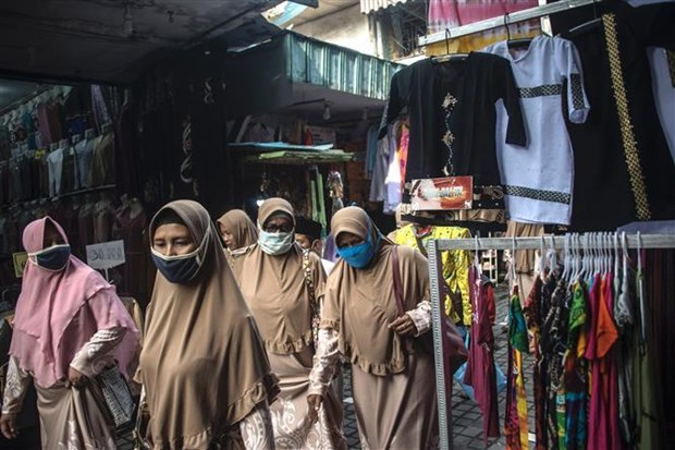 Dich COVID-19: Indonesia cam nguoi dan ve que trong dip le Eid al-Fitr hinh anh 1
