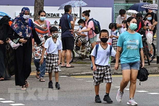 Dich COVID-19: Singapore nang cap co so cham soc cong dong hinh anh 1