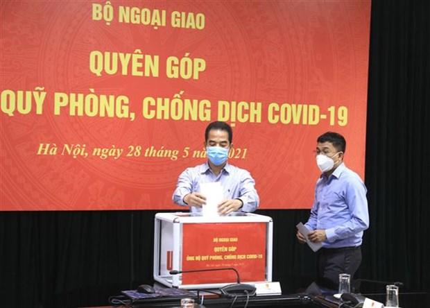 Bo Tai chinh lap BQL Quy Vaccine, tiep nhan kinh phi phong chong dich hinh anh 1