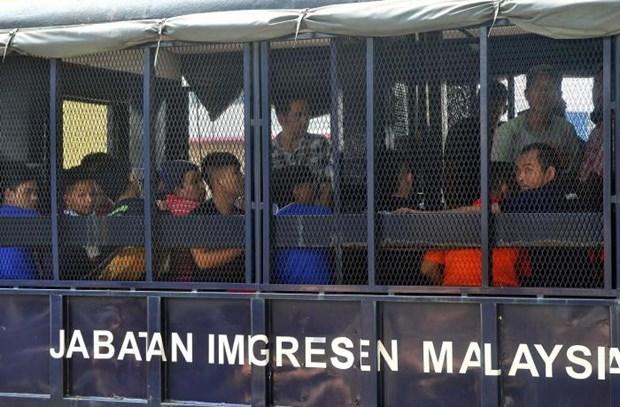 Malaysia phat nang to chuc, ca nhan su dung lao dong bat hop phap hinh anh 1