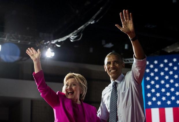 Tong thong My Obama di van dong tranh cu cho ba Clinton hinh anh 1