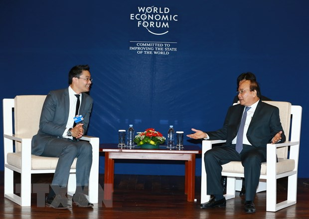 Thu tuong tiep cac lanh dao WEF, AIIB va Tap doan Cisco hinh anh 1