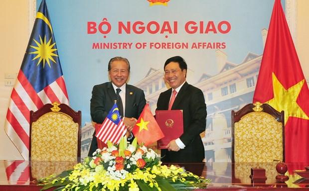 Viet Nam-Malaysia ton trong giai quyet hoa binh van de Bien Dong hinh anh 1