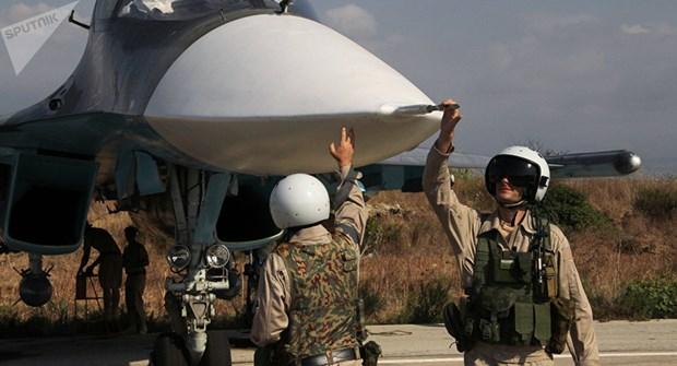 Phien quan Syria dung may bay khong nguoi lai tan cong can cu Nga hinh anh 1
