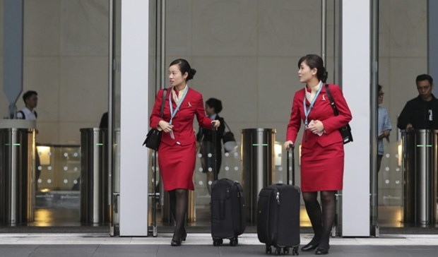 Cathay Pacific ngung quy dinh nu tiep vien chi mac vay khi lam viec hinh anh 1
