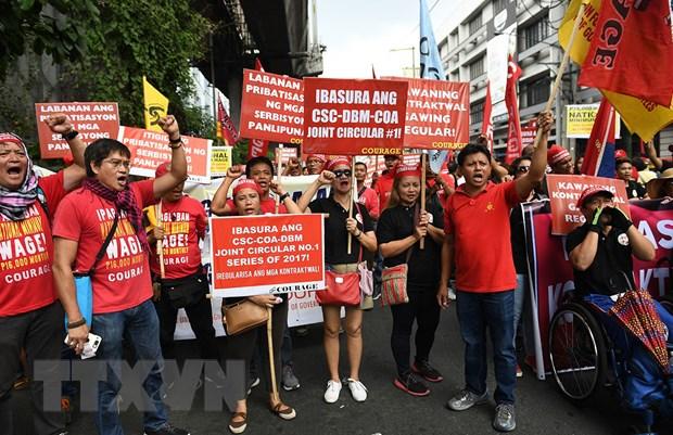 Philippines: Tuan hanh lon yeu cau chinh phu sua chinh sach lao dong hinh anh 1