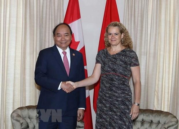 Thu tuong gap cuu Thu tuong Canada J.Chretien va Tong Thu ky OECD hinh anh 1