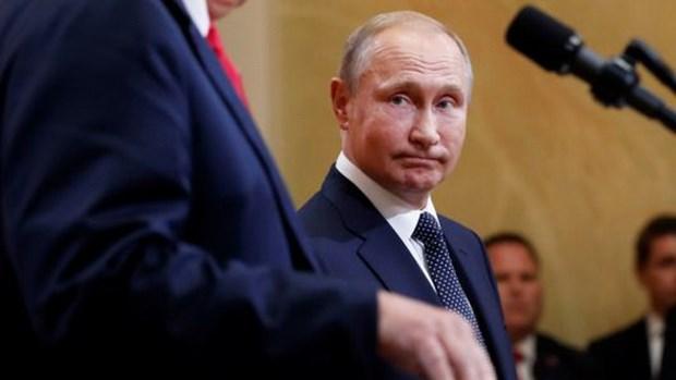 Ong Putin: Toa an quyet dinh Nga co can thiep bau cu My hay khong hinh anh 1