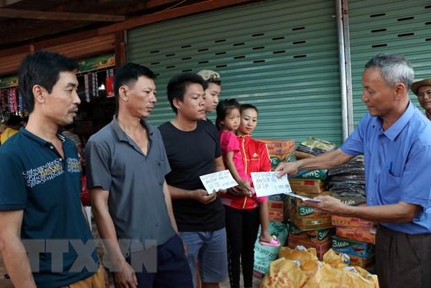 Chinh phu va nhan dan Viet Nam ho tro khac phuc su co vo dap o Lao hinh anh 1
