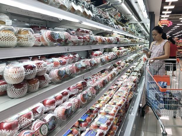 Suc mua thi truong Tet tai Thanh pho Ho Chi Minh tang tu 12-15% hinh anh 1