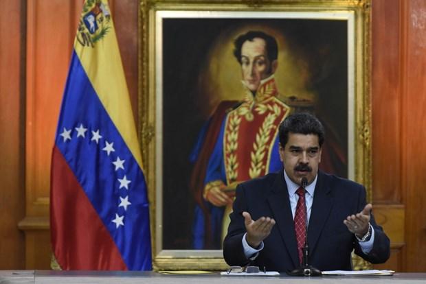 Chinh phu Venezuela va mot bo phan phe doi lap ky thoa thuan doi thoai hinh anh 1