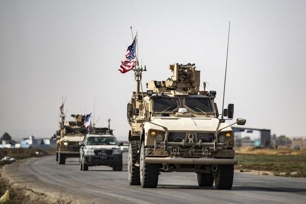 Quan doi My ram ro rut quan khoi Syria sang lanh tho Iraq hinh anh 1