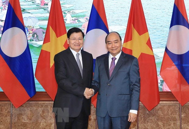 Thu tuong Lao Sisoulith ket thuc chuyen tham, lam viec o Viet Nam hinh anh 1