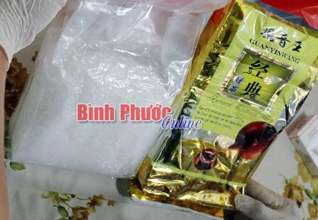 Bat giu hai doi tuong mang gan 1 kg ma tuy da tu TPHCM den Binh Phuoc hinh anh 1