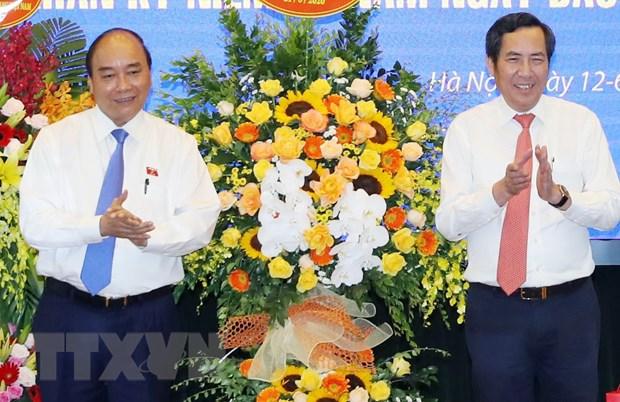 Thu tuong tham, chuc mung Bao Nhan Dan nhan dip Ngay Bao chi Cach mang hinh anh 1