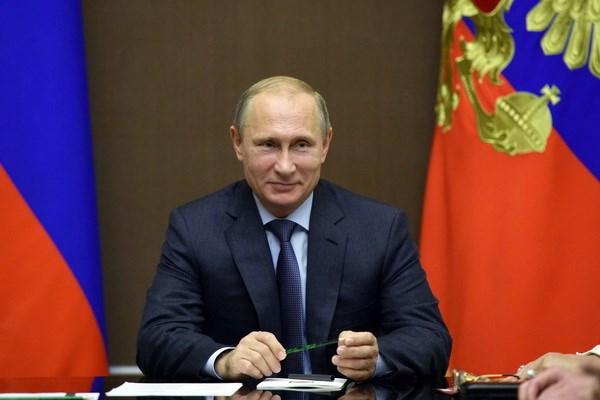 Tong thong Putin: My khong the gay ap luc voi Nga ve Ukraine hinh anh 1