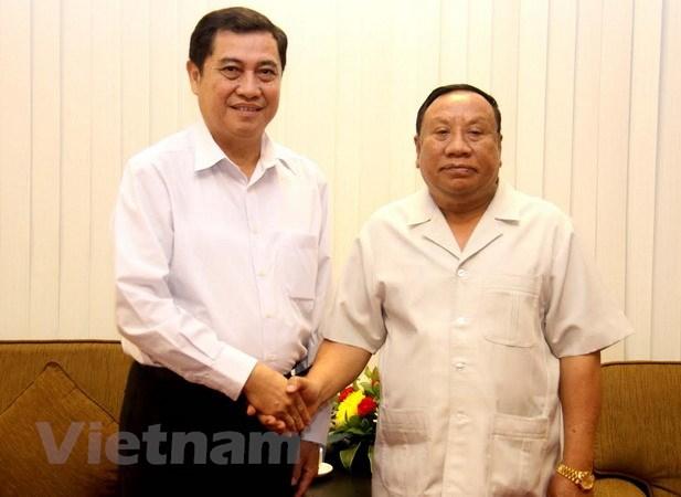 Viet Nam-Lao tang cuong trao doi kinh nghiem cong tac dan toc hinh anh 1