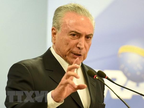 Brazil: Dang trong lien minh cam quyen yeu cau Tong thong tu chuc hinh anh 1