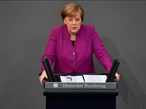 Ba Merkel canh bao Trung Quoc khong gan dau tu voi yeu sach chinh tri hinh anh 1