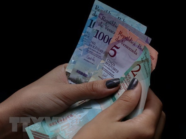 Venezuela loai dong USD khoi thi truong hoi doai nham tra dua My hinh anh 1