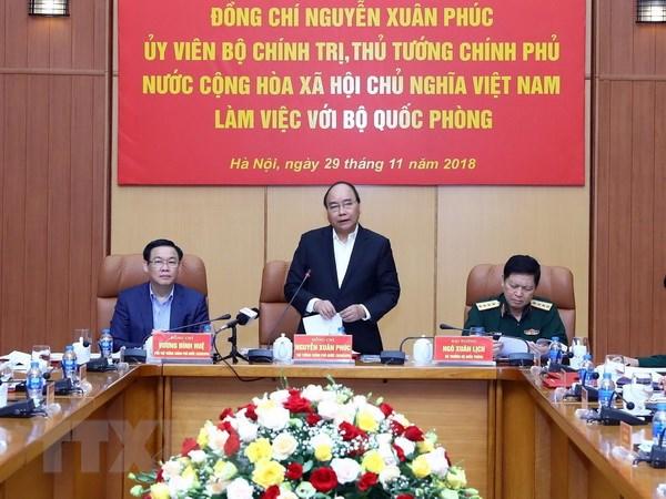 Thu tuong Nguyen Xuan Phuc lam viec voi lanh dao Bo Quoc phong hinh anh 1