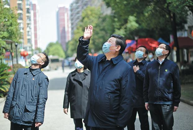 Trung Quoc: Mot so cong ty o tam dich Vu Han hoat dong tro lai hinh anh 1